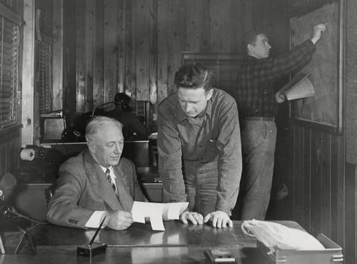 Harold, John, and Thomas Anderson (from left to right) in The Andersons company office, ca. 1950