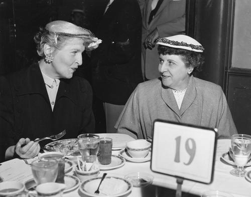 Photograph: Kick-off luncheon: From left: Mrs. Geraldine Simon, of Geraldine's Children's Shop, Mrs. Freeda Jacobs, Manager of Schiller's Millinery