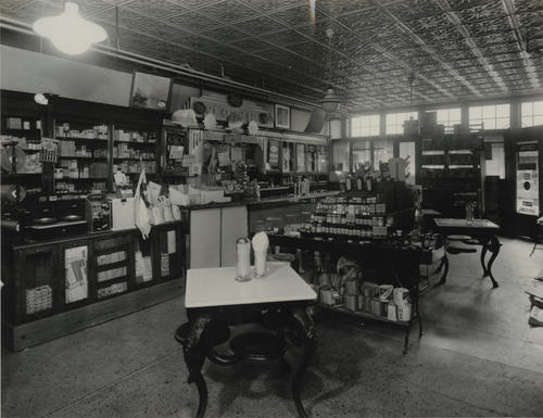 Photograph of Ella P. Stewart and her pharmacy on Indiana Ave in 1948.