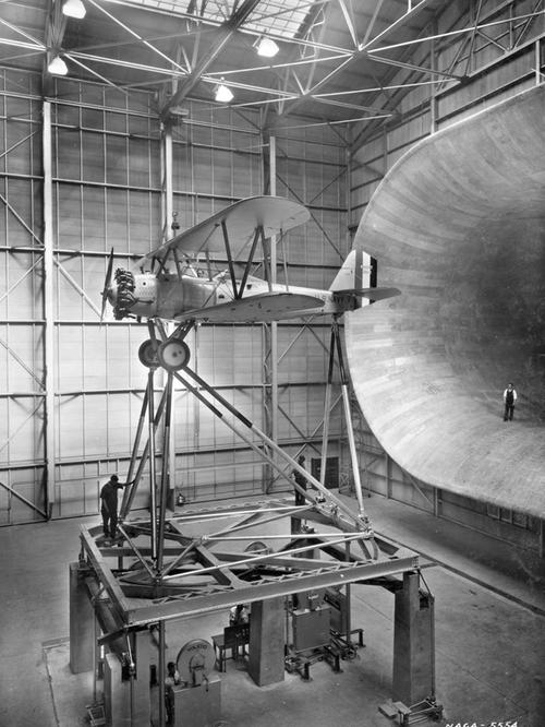 Scale used to measure forces on airplane in front of wind tunnel