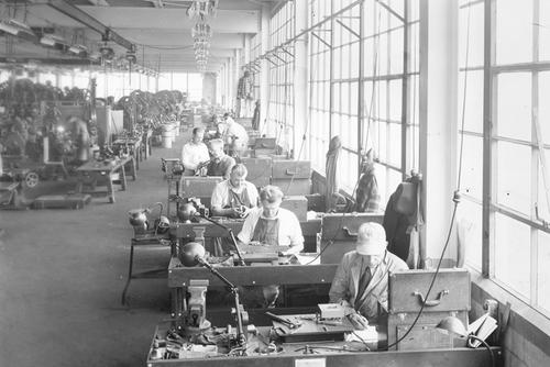 Production floor with workers and machines