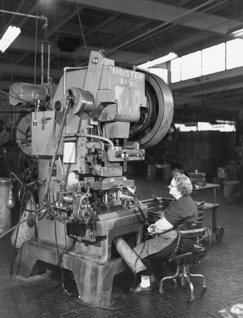 Employee operating the Minster B1-60 press for high-sped production