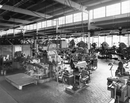 Production floor with tool making machines showing brands like Cincinnati, LeBlond, B and B, and Minster 6s in the background