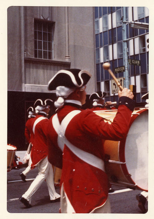 American Revolution Bicentennial Parade in Toledo 1977. Final shot, focusing on the bass drummers of the percussion section near a parking garage on 200 block St. Clare near Madison