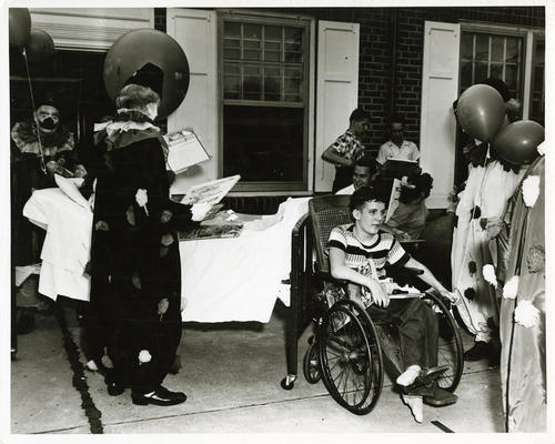 Photo of an event at Opportunity Home. Unidentified photo both in credit and focus.