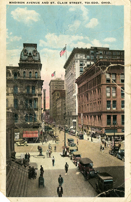 Madison Avenue and St. Clair Street, Toledo, Ohio. Postcard that is showing signs of wear that was postmarked in 1924. It was sent from Toledo to Middlefield Ohio. There is a message on the back.