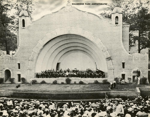 "Walbridge Park Amphitheatre. Un-mailed Jumbo Postcard, with a caption that reads ""The large music shell and stage, a part of the Walbridge Park Museum of Science Building, faces an amphitheatre seating 5,000 persons or more. Symphony orchestras give regular summer concerts, light operas, and ballets, sometimes drawing an attendance of 10,000 eager spectators to a single performance."""