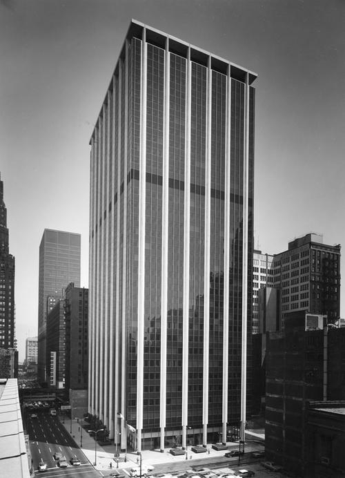 "LOF glass used in the Illinois Bell Telephone office Tower in Chicago, featuring Black Pearl Vitrolux spandrels and 3/8"" thick grey-tinted glass."