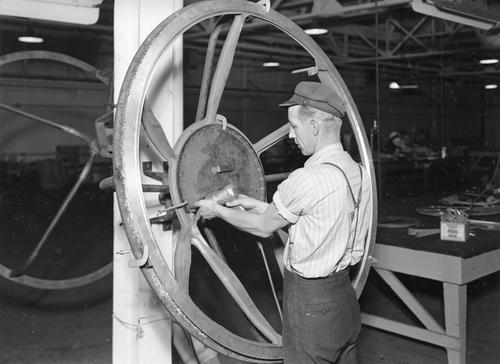 Drilling holes in casting to anchor windows in B-29 nose
