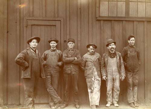 Workers outside the Toledo Glass Company's experimental plant