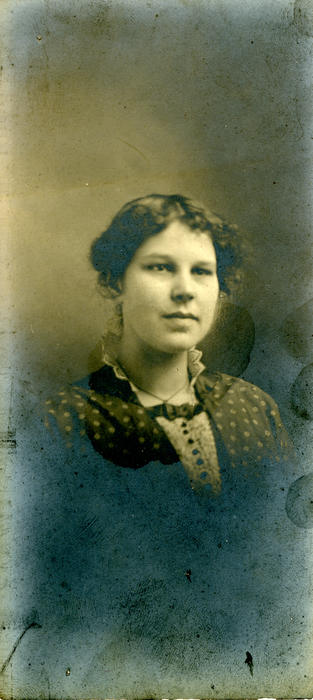 A photo, possibly that of Olive Colton.  No annotation on the back