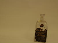 Bitters bottle, rectangular cross section, sloping