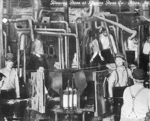 "Blowing glass at Illinois Glass Co., Alton, Ill.  handwritten notation on the back says ""date unknown"""