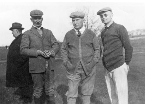 Owens (in the middle) with William E. Boshart and Paul Welch at a golf game in Orlando, Florida.
