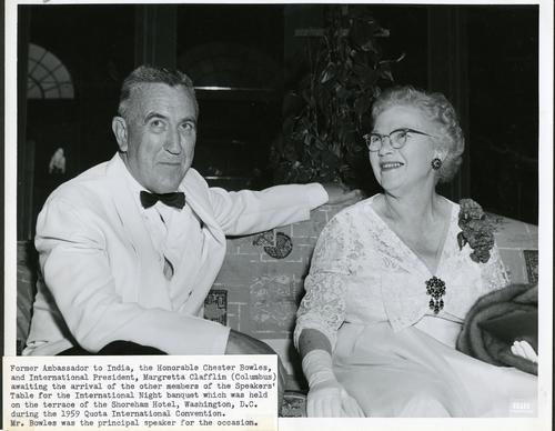 Photograph of Former Ambassador to India, Chester Bowles, and International President of Quota, Margretta Clafflin, at the International Night banquet in Washington DC in 1959.