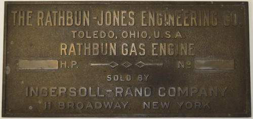 "Plaque: ""The Rathbun-Jones Engineering Co., Toledo, Ohio, U. S. A. Rathbun Gas Engine [blank] H. P.  No. [blank] Sold by Ingersoll-Rand Company, 11 Broadway, New York"""