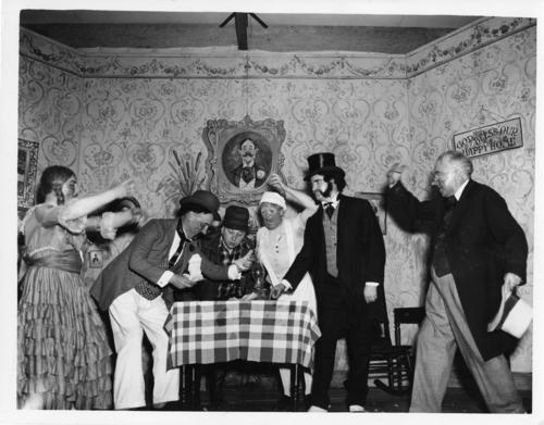 "Photo of a Rotary performance.  It looks to be a scene from  the play ""Cyrano de Bergerac"" by Edmond Rostand however there is no documentation to support that."