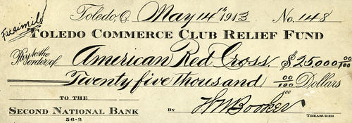 A facsimile of a $25,000 check made out to the American Red Cross from the Toledo Commerce Club Relief Fund, signed by Booker.  flood relief