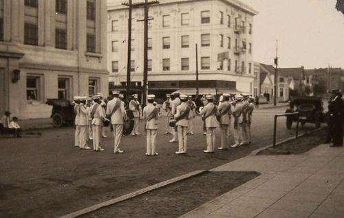 Raja Yoga College band playing in white uniforms.