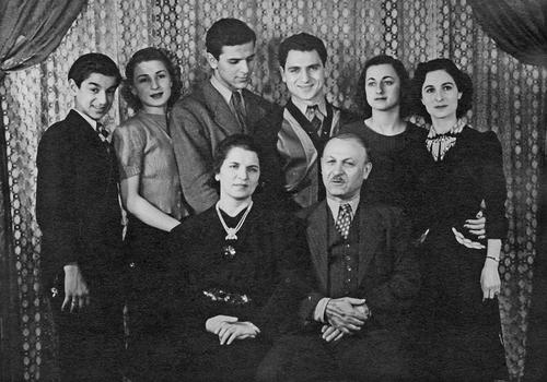 Photograph taken in the Joseph Family home. This photo was taken in Carl Joseph's parents' home located in, what was then, the heart of Toledo's Arab community. Front Row: Edma and George; Back Row: Richard Joseph, Evaughn, Albert, Carl, Madeline, and Nazeema.
