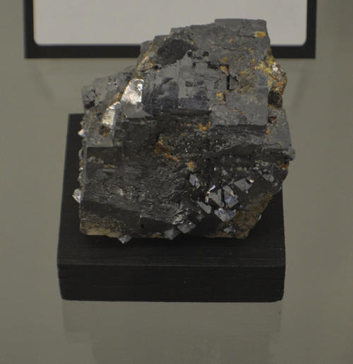 PbS - Mohs Hardness: 2 1/2.  Galena is very easy to identify. Freshly broken pieces exhibit perfect cleavage in three directions that intersect at 90 degrees. It has a distinct silver color and a bright metallic luster.