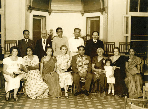 "Description on the back reads: ""1st All-India Population and Family Planning Conf. Bombay, 1951 (Daddy is the president look at his garland), Lady Rama Rao to daddy's left"""