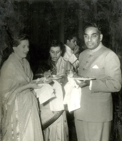 "Description on the back: ""1952? International Planned Parenthood Conference in new Delhi; left to right: Ann Chandrasekhar, Indira Gandhi, and the author [Chandrasekhar] having light refreshments., This photograph and others in the same folder have been partially damaged."